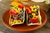picture of tacos  - Mexican food Taco in clay plate on wooden table - JPG