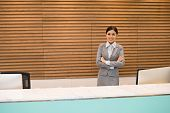 stock photo of receptionist  - Portrait of attractive Vietnamese office receptionist at her workplace - JPG