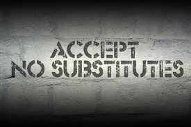 picture of substitutes  - accept no substitutes stencil print on the grunge white brick wall - JPG