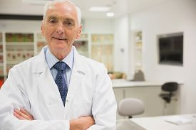 picture of professor  - Science professor smiling at camera at the university - JPG