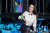 Smiling Brunette Bartender Pouring Martini poster