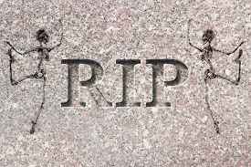 stock photo of headstones  - Engraved headstone spelling the letters RIP with Skeletons  - JPG