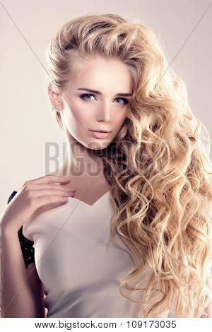 Model with long hair Blonde Waves Curls Hairstyle Hair Salon Updo Fashion model with shiny hair Woma