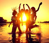 Vacation. Beach Party. Teenage girls having fun in water. Group of happy young people dancing at the poster