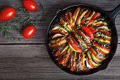 Постер, плакат: Vegetable ratatouille baked in cast iron frying pan homemade preparation recipe healthy diet french