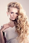 Постер, плакат: Model with long hair Blonde Waves Curls Hairstyle Hair Salon Updo Fashion model with shiny hair Woma