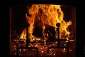 pic of cozy hearth  - fire burning in the hearth with black background - JPG