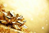 picture of new years celebration  - Shinning Christmas background with a golden gift - JPG