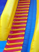 stock photo of inflatable slide  - Steps on an inflatable childrens slide - JPG