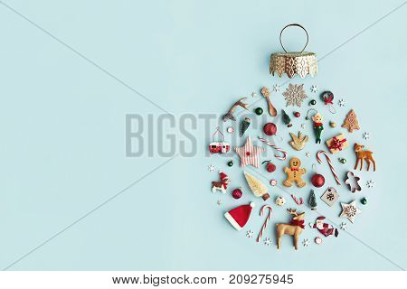 poster of Christmas objects laid out in the shape of a Christmas bauble, overhead view