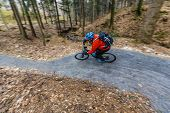 Cycling in autumn mountains forest landscape. Man cycling MTB enduro flow trail track. Outdoor sport poster