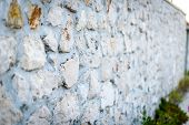 Stone Rock Fence Or Gabion And Road Or Footpath. poster