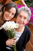 pic of mother daughter  - mother and daughter portrait outdoors with flowers - JPG