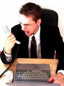 stock photo of angry man  - angry executive screaming on the phone - JPG