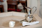 stock photo of baptism  - Baptism detail with holy water and silver vessel - JPG