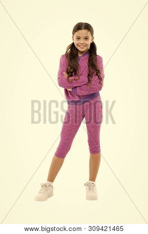 poster of Girl Cute Kid With Long Ponytails Wear Sportive Costume Isolated On White. Sport For Girls. Guidance