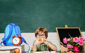 Little Pupil Having Lunch With Apple In Classroom. School Lunch During Break Time. School Lunch For  poster