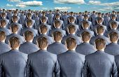 Rear view of many identical businessmen clones