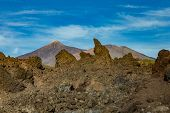 Mountains And Lava Fields Around Volcano Teide, Partly Covered By The Clouds. Bright Blue Sky. Teide poster