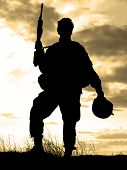 pic of special forces  - Silhouette of US soldier with rifle against a sunset - JPG