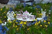 Tiny Table With Small Dishware And Tea Cups, Small Chairs In Spring Flowers. Fairy Tea Party.  Greet poster