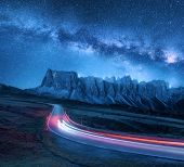 Milky Way Over Mountain Road At Night In Summer. Blurred Car Headlights On Winding Road. Colorful La poster