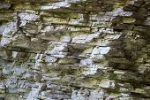 Texture, Background Layers And Cracks In Sedimentary Rock On Cliff Face. Cliff Of Rock Mountain. Roc poster