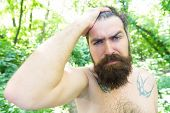 Sweating And Body Odor Care. Perspiring Hipster Touching His Wet Hair. Bearded Man Experiencing Swea poster