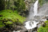 stock photo of rabbi  - Water drop of the so called Saent waterfalls formed by the river Rabbies in the Italian Dolomites - JPG