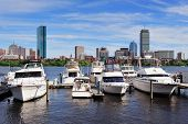 stock photo of prudential center  - Boston Charles River cityscape with urban city skyline skyscrapers and boats with blue sky - JPG
