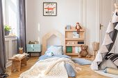 Cozy Kids Bedroom With Blue Bedding And Warm Blanket On The Bed, Real Photo With Mockup Poster On Th poster