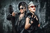 A portrait of two stylish punk men in the street. Modern men fashion, rock musicians. poster