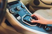 Close Up Young Woman Hand On Automatic Gear Shift, Shifting Gearbox In Car.driver Woman Hand Holding poster