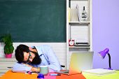 Tired Teacher Sleeping In Classroom. Hard Work. School Job. Teacher Preparing For University Exams.  poster