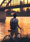 Cycling In Sunset. Lifestyle Concept. Hipster Woman Cycling In Sunset In City. Healthy Lifestyle. Pe poster