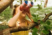 Portrait Of Cute Little Explorer Girl Looking Through A Binoculars Exploring And Learning The Nature poster
