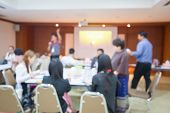 Blurry Image. Speaker Or Lecturer With Startup Business Team Brainstorming On Meeting Workshop. Team poster