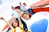 pic of family vacations  - Happy kids traveling by airplane for their vacations - JPG