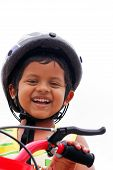 Young Indian Boy With Helmet Expressing Happiness