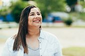 Portrait Of Beautiful Plus Size Woman In The Park poster