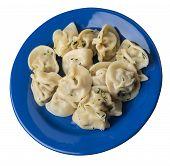 Dumplings On A Blue Plate Isolated On White Background .boiled Dumplings.meat Dumplings Top Side Vie poster