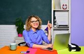 Student In College. Young Teacher In Glasses Over Green Chalkboard Background. High School Concept.  poster