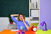 Tired Female Teacher In Classroom. Back To School. Online Education. Portrait Of Female University T poster