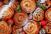 Cinnamon Raisin Bun Sweet Roll Pastry Flat Lay. Danish Bakery Cake With Strawberry And Sugar Powder  poster