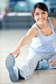 stock photo of stretching exercises  - gym woman doing stretching exercise at the gym - JPG