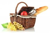 Picnic basket with fruits,bread and thermos isolated on white