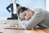 pic of boredom  - Young businesswoman sleeping during meeting - JPG
