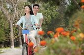 image of tandem bicycle  - Couple riding tandem bicycle in Beijing - JPG