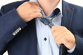stock photo of take off clothes  - tired businessman taking off necktie - JPG