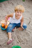 Little Girl In Sandbox